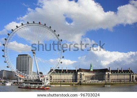 LONDON - MARCH 3 : London Eye, erected in 1999, is a giant (135m.) ferris wheel situated on the banks of the river Thames on March 3, 2012 in London, UK. It is the most popular attraction of the UK. - stock photo
