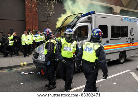 LONDON - MARCH 26: Riot police come under attack during a large anti-cuts rally on March 26, 2011 in London, UK. - stock photo