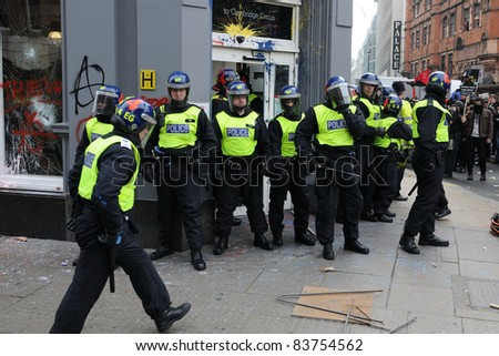 LONDON - MARCH 26: Riot police secure a branch of HSBC after the bank is occupied by a breakaway group of protesters during a large anti-cuts rally on March 26, 2011 in London, UK.