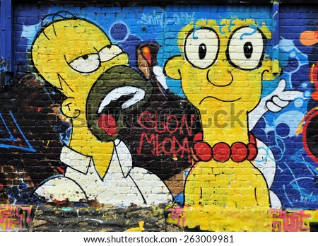 LONDON - MARCH 22, 2015. Simpson's characters Homer and Marge are celebrated on a brick wall off Pedley Street at Shoreditch, in the Borough of Tower Hamlets, an area renown for street art in London. - stock photo
