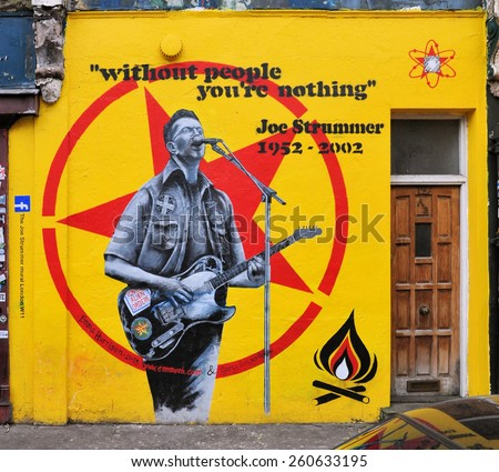 LONDON - MARCH 14. 2015. Street art remembrance painting by Emma Harrison and Gary Loveridge of Joe Strummer, punk rock guitarist, songwriter and lead vocalist of Clash, in west London, UK. - stock photo