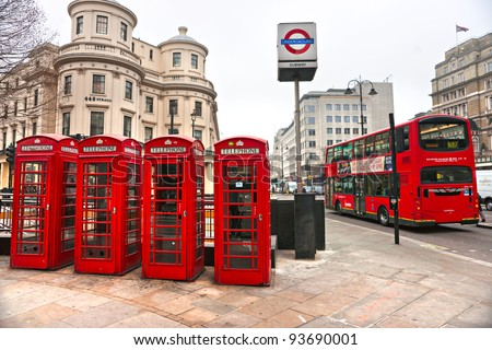 LONDON - MARCH 17: Telephone boxes and underground logo. Transport for London announced that the 'Underground' logo will also be used for other transportation systems, March 17, 2011 in London, UK. - stock photo