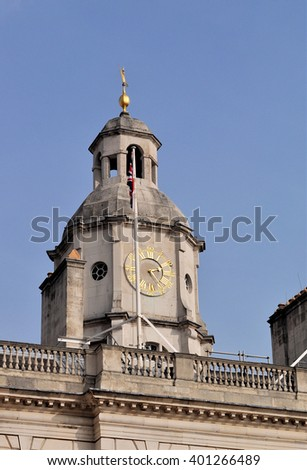 LONDON - MARCH 12, 2016. The clock tower of the Household Cavalry Museum overlooking Horse Guard's Parade, the site of the annual Trooping the Colour and other ceremonies in London, UK. - stock photo