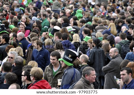 LONDON - MARCH 18: The crowd during the St Patrick's Day Parade and Festival at Trafalgar Square on March 18, 2012 in London, UK.
