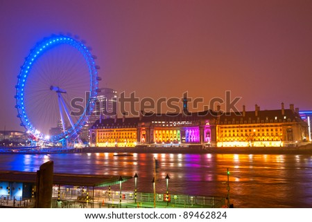 LONDON - MARCH 19 : The London Eye, erected in 1999, is a giant (135mt.) ferris wheel situated on the banks of the river Thames on March 19, 2011 in London, UK. It is the most popular attraction of the UK. - stock photo