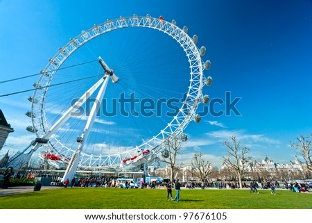 LONDON - MARCH 19 : The London Eye, erected in 1999, is a giant (135mt.) ferris wheel situated on the banks of the river Thames. Is the most popular attraction of the UK. March 19, 2011 in London, UK. - stock photo