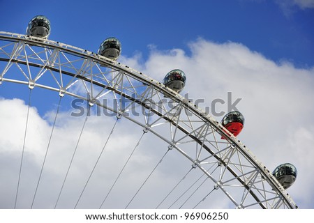 LONDON - MARCH 3: The London Eye on March 3, 2012 in London, England. It was built in 1999. The wheel stands 443 feet (135 meters) tall. 10,000 people visiting each day. - stock photo