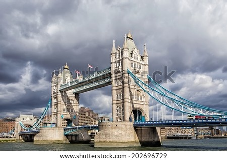 LONDON - MARCH 23: Tower Bridge on March 23, 2014 in London. Tower Bridge (built 1886�1894) is a combined bascule and suspension bridge in London which crosses the River Thames. - stock photo
