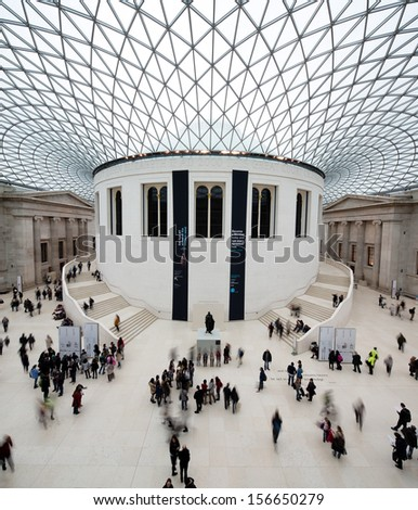 LONDON - MARCH 7: Unique image of people visiting the main court of the British Museum - museum of human history and culture and one of the top attractions of London. London, UK, March 7, 2013. - stock photo