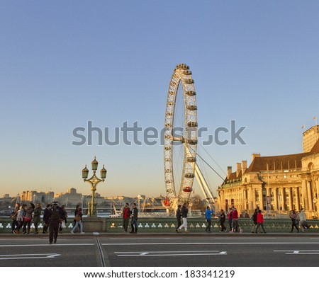 LONDON - MARCH 7:  View of London Eye,which is the tallest ferris wheel in Europe, along the Thames River on March 7, 2014  in London.  - stock photo