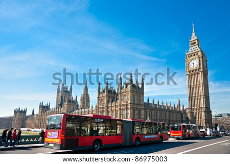 LONDON - MARCH 19:Wide angle view of the Big Ben and double-decker bus on March 19, 2011 in London. The Big Ben is the largest four-faced chiming clock in the world, and was built in 1288. - stock photo