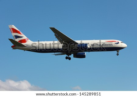 LONDON - MAY 25: A British Airways Boeing 767 on approach on May 25, 2013 in London. British Airways is the flag carrier airline of the United Kingdom with its main hub at London Heathrow Airport. - stock photo