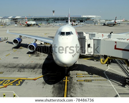 LONDON - MAY 24: A British Airways 747 jumbo jet parks at gate at Heathrow Airport in London on May 24, 2009. Heathrow had 65.7 million passengers arriving and departing in 2010.