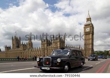 LONDON - MAY 31: A London Black Cab on Westminister Bridge on May 31, 2011. The Black Cabs are regulated by Transport For London and are the only vehicles for hire that can be hailed on the street. - stock photo