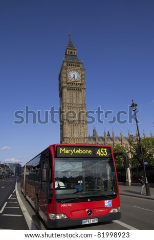 LONDON - MAY 29:  A London Bus with Big Ben on May 29, 2011 in London England. The London Bus service is one of the largest urban bus networks in the world with 8000 buses covering 700 routes. - stock photo