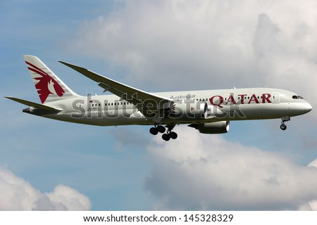LONDON - MAY 25: A Qatar Airways Boeing 787 Dreamliner on approach on May 25, 2013 in London. The Boeing 787 is the world's first airliner using composite material in the construction of its airframe. - stock photo
