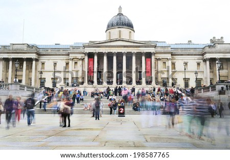 LONDON - MAY 30, 2013: A slow exposure of Trafalgar Square, facing the National Gallery  in London. Trafalgar Square is the busy heart of London. - stock photo
