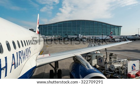 LONDON - MAY 21, 2015: Airplanes operations in Heathrow Airport, the busiest airport in the United Kingdom and the busiest airport in Europe by passenger traffic.  - stock photo