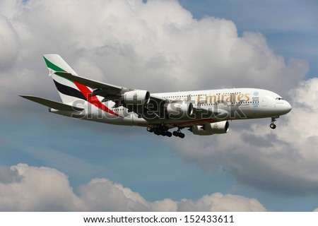 LONDON - MAY 25: An Emirates Airbus A380 Superjumbo on approach on May 25, 2013 in London. The Airbus A380 is the world's largest passenger airliner. Emirates is an airline based in Dubai. - stock photo