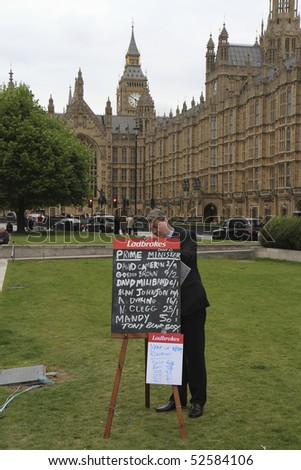LONDON - MAY 7 : Betting odds for Prime Ministers during the UK General Election of May 6 2010 outside Parliament in Westminster. The betting odds are for who will be the next Prime Minister - stock photo