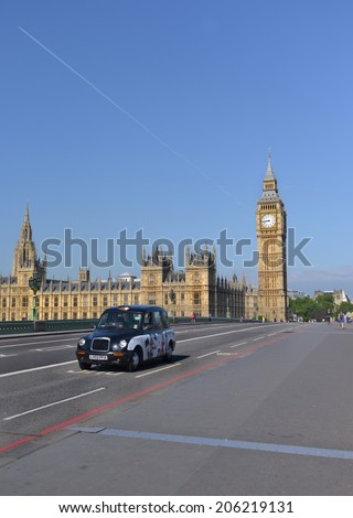 LONDON - MAY 31, 2014: Big Ben is the name of the bell inside the clock tower, located along the Thames in London. - stock photo