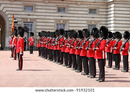LONDON - MAY 21: British Royal guards perform the Changing of the Guard in Buckingham Palace on May 21, 2010 in London, UK - stock photo