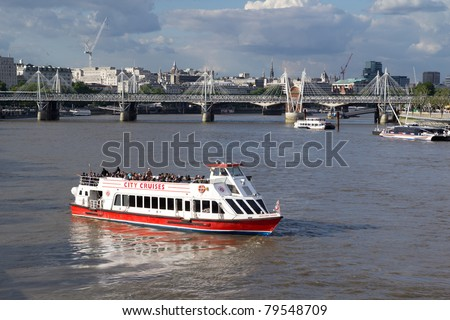 LONDON - MAY 31: City Cruises has revealed plans to build London´s largest tour boat ahead of the 2012 London Olympics. A City Cruises tour boat on the Thames River on May 31, 2011 in London, England. - stock photo