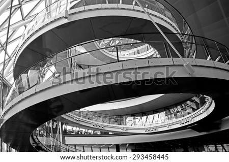 LONDON - MAY 13 2015:City Hall, London England UK.A 500-metre (1,640 ft) helical walkway, reminiscent of that in New York's Solomon R. Guggenheim Museum, ascends the full height of the building. - stock photo