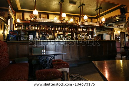 LONDON - MAY 16: Interior of pub, for drinking and socializing, focal point of community, on May 16, 2012, London, UK. Pub business, now about 53,500 pubs in the UK, has been declining every year - stock photo