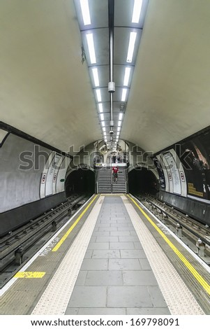 LONDON - MAY 30, 2013: Interior view of Clapham Common (opened in June 1900) - Underground Tube station in London. London's system is the oldest underground railway in the world, dating back to 1863. - stock photo