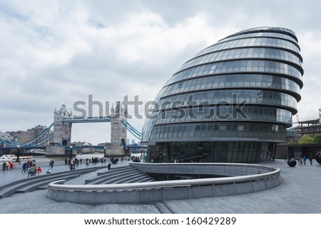 LONDON - MAY 19: London City Hall and Tower Bridge on May 19, 2013 in London, UK. - stock photo
