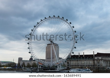 LONDON - MAY 05 : London Eye on Thames river on May 05, 2013.The London eye is the biggest ferris wheel in Europe at 443ft tall, London, United Kingdom - stock photo