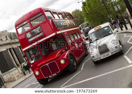 LONDON - May 6 : London Taxi, also called hackney carriage, and an old bus on May 6, 2014 in London, UK.  - stock photo