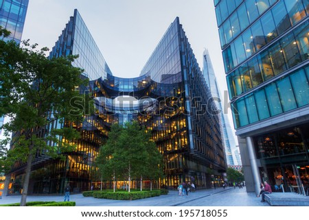 LONDON - MAY 19: office building of PricewaterhouseCoopers on May 19, 2014 in London. PWC is a multinational professional services network, the world's second largest. - stock photo