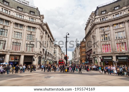 LONDON - MAY 20: Oxford Circus with unidentified people on May 20, 2014 in London. Up to over 40.000 pedestrians per hour pass the junction, it is the highest pedestrian volumes recorded in London. - stock photo