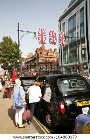 LONDON - MAY 24: Oxford Street in London, decorated with union jack flags to celebrate the Queen's diamond Jubilee on May 24, 2012 in London. The main celebrations held from June 2 to June 5 - stock photo