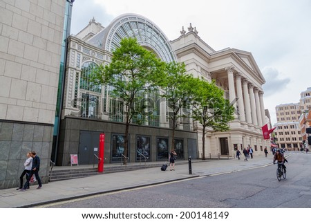 LONDON - MAY 21: Paul Hamlyn Hall of the Royal Opera House with unidentified people on May 21, 2014 in London. The Royal Opera House is the most important opera house in Great Britain. - stock photo