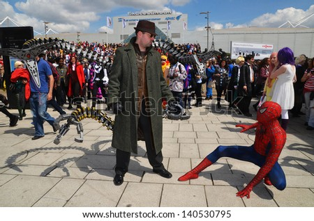 London - May 26: People dressing up in Cosplay costume to take part in the MCM expo which has the largest gathering of Cosplayers in the country,  London May 26th, 2013 in London England.    - stock photo