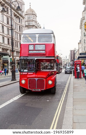 LONDON - MAY 21: red double-decker bus on May 21, 2014 in London. The red busses are one of the main iconic symbols of London. - stock photo