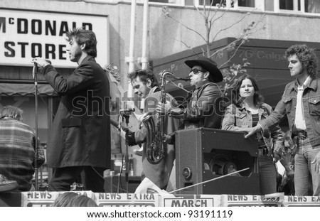 "LONDON - MAY 15: Rockabilly band ""The Flying Saucers"" play during the Rock 'n' Roll Radio Campaign march on May 15, 1976 in London, England. The campaign wants more Rock 'n' Roll music on British radio."