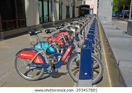 LONDON - MAY 13 2015:Santander Cycles Hire Station.London's public bike sharing scheme is available 24/7, 365 days a year. with more than 10,000 bikes and over 700 bike docking stations across London. - stock photo
