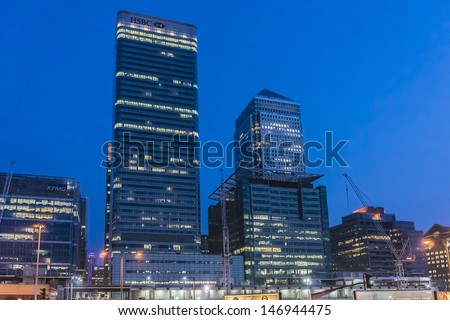LONDON - MAY 26: Skyscraper One Canada Square and HSBC UK Head Quarter at night on May 26, 2013, Canary Wharf, London. Canary Wharf is a major business district located in Borough of Tower Hamlets. - stock photo