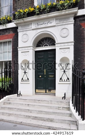 LONDON - MAY 21, 2016. The doorway to number one Bedford Square a fine 18th century English Georgian period Grade One Listed townhouse, in the Borough of Camden, London, UK. - stock photo