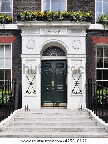 LONDON - MAY 21, 2016. The entrance to number one Bedford Square; a fine 18th century, c1775, English Georgian period Grade One Listed townhouse at Bloomsbury in the Borough of Camden, London.