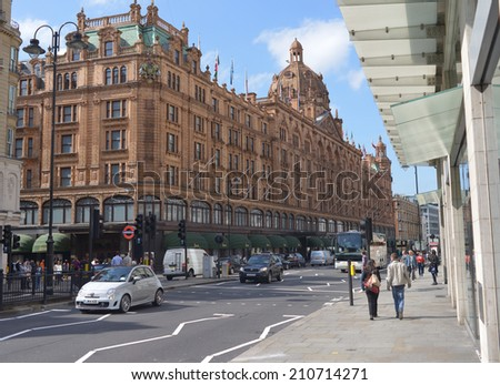 LONDON - MAY 31, 2014: The famous department store Harrods in London. First Harrods was opened at 1849 and now it is one of the most famous luxury store in London. - stock photo