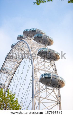 LONDON - MAY 21: The London Eye on May 21, 2013 in London. The entire structure of the London Eye is 135 meters tall and the wheel has a diameter of 120 metres. - stock photo