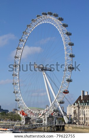 LONDON - MAY 29: The London Eye on May 29, 2011 in the capital city of London.  The London Eye is the most popular attraction of the UK and the tallest Ferris Wheel in Europe at 135 meters (443 feet). - stock photo