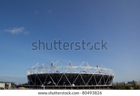 LONDON - MAY 31: The 2012 London Olympic stadium nears completion in Stratford London on May 31, 2011. The Stadium will have a capacity of 80,000 during the 2012 Olympic Games. - stock photo