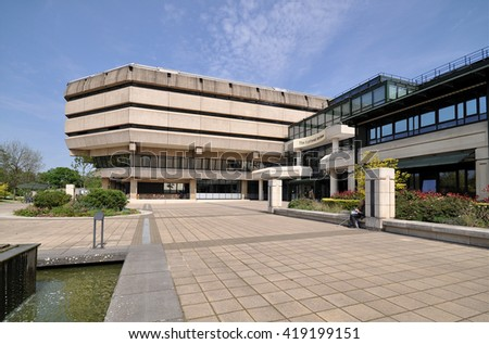 LONDON - MAY 7, 2016. The National Archives of the UK building was opened in 1977 and contains 1000 years of historical information and public records, located at Kew, Richmond, London, UK. - stock photo