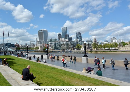 LONDON -  MAY 14 2015:The Queen's South Bank Walk London.It's a sightseeing walk for tourists and visitors that follows the River Thames Southbank path from Westminster Bridge to the Tower Bridge. - stock photo